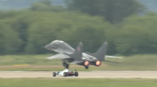 Watch a Russian fighter jet race a Formula One car