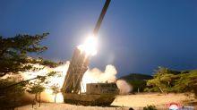 North Korea says tested 'super-large' rocket launchers