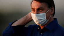 Brazil's Bolsonaro says coronavirus restrictions kill economy