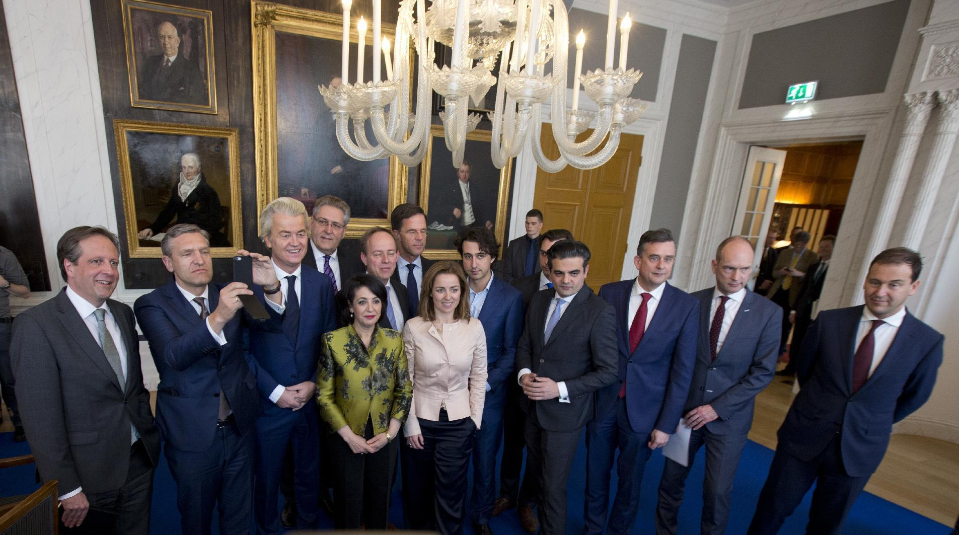 Political party leaders pose for a group picture with Khadija Arib, center left, the chairwoman of parliament, prior to discussing first steps in forming a new dutch coalition government in The Hague, Netherlands, Thursday, March 16, 2017. Dutch political parties were preparing Thursday to start what will likely be a long process of coalition talks after Prime Minister Mark Rutte's right-wing VVD easily won national elections, defying polls that suggested a close race with anti-Islam populist Geert Wilders. (AP Photo/Peter Dejong)