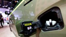 At Frankfurt auto show, Merkel urges car industry to restore trust