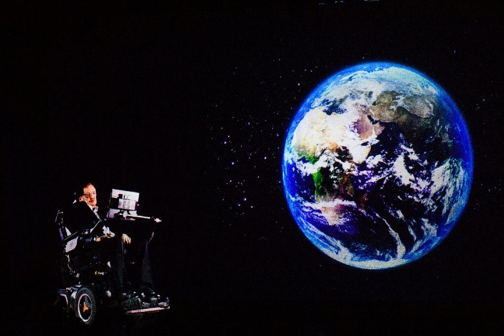 Stephen Hawking speaks to an audience by hologram in Hong Kong, beamed live from his Cambridge office in March 2017 (AFP Photo/Anthony WALLACE)