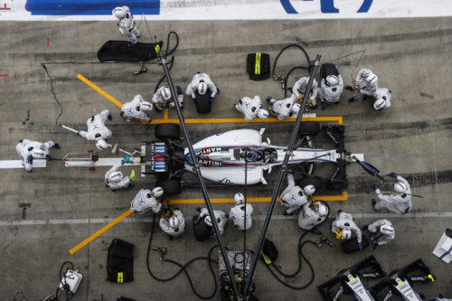 The Williams F1 pit crew get to work on Felipe Massa's car
