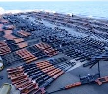 Video shows a US Navy haul of illegal weapons so big that the rifles, machine guns, and RPGs covered the deck of a missile cruiser