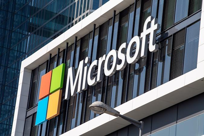 26 March 2021, Bavaria, Munich: The Microsoft logo hangs on the facade of an office building in Parkstadt Schwabing, in the north of the Bavarian capital. Photo: Peter Kneffel/dpa (Photo by Peter Kneffel/picture alliance via Getty Images)