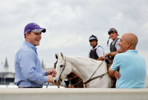 Norman Casse, left, and his father, Mark, chat during a workout at Churchill Downs. (Getty)