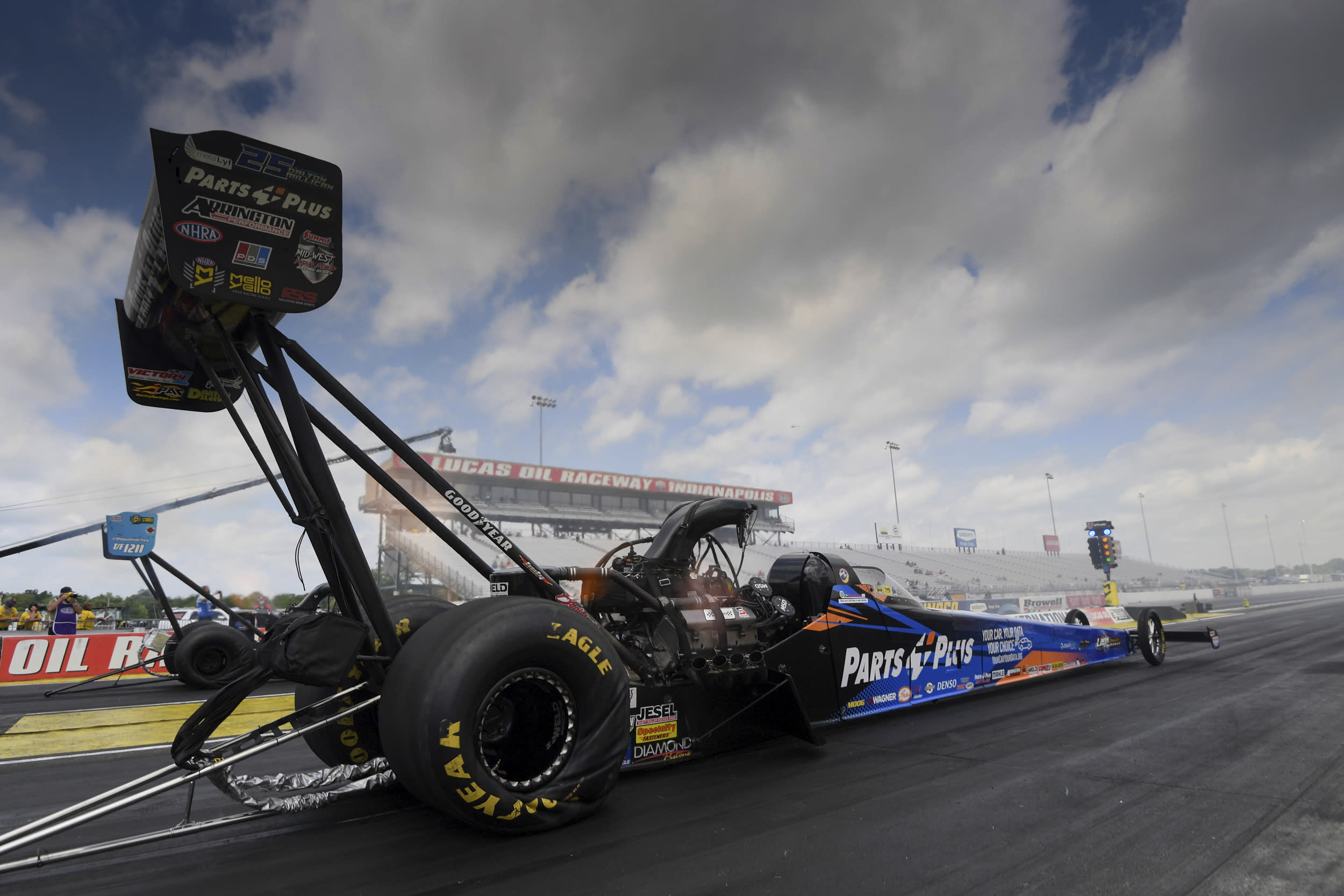 In this photo provided by the NHRA, Top Fuel's Clay Millican powers his way to the top spot to wrap up qualifying at the Lucas Oil NHRA Summernationals at Indianapolis, Saturday, July 18, 2020. ( Jerry Foss/NHRA via AP)