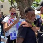 Michigan Sheriff Chris Swanson Lays Down Riot Gear and Joins March