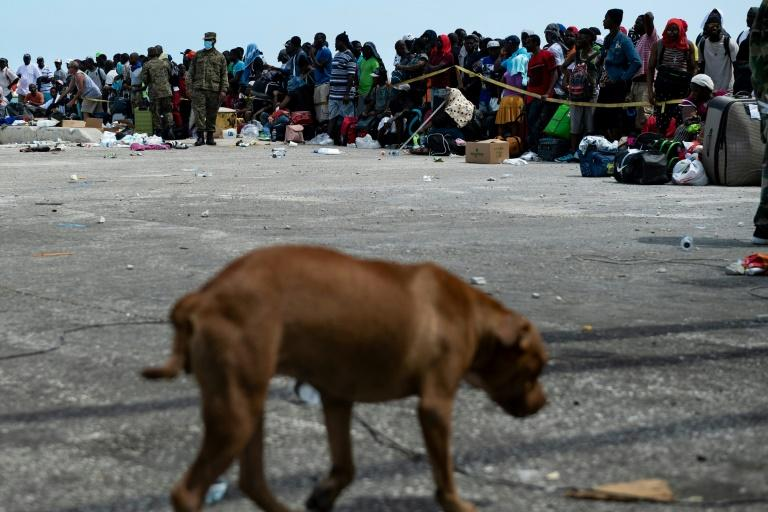 People await evacuation at a dock in devastated Marsh Harbour, Bahamas, on September 7, 2019, in the aftermath of Hurricane Dorian (AFP Photo/Brendan Smialowski)