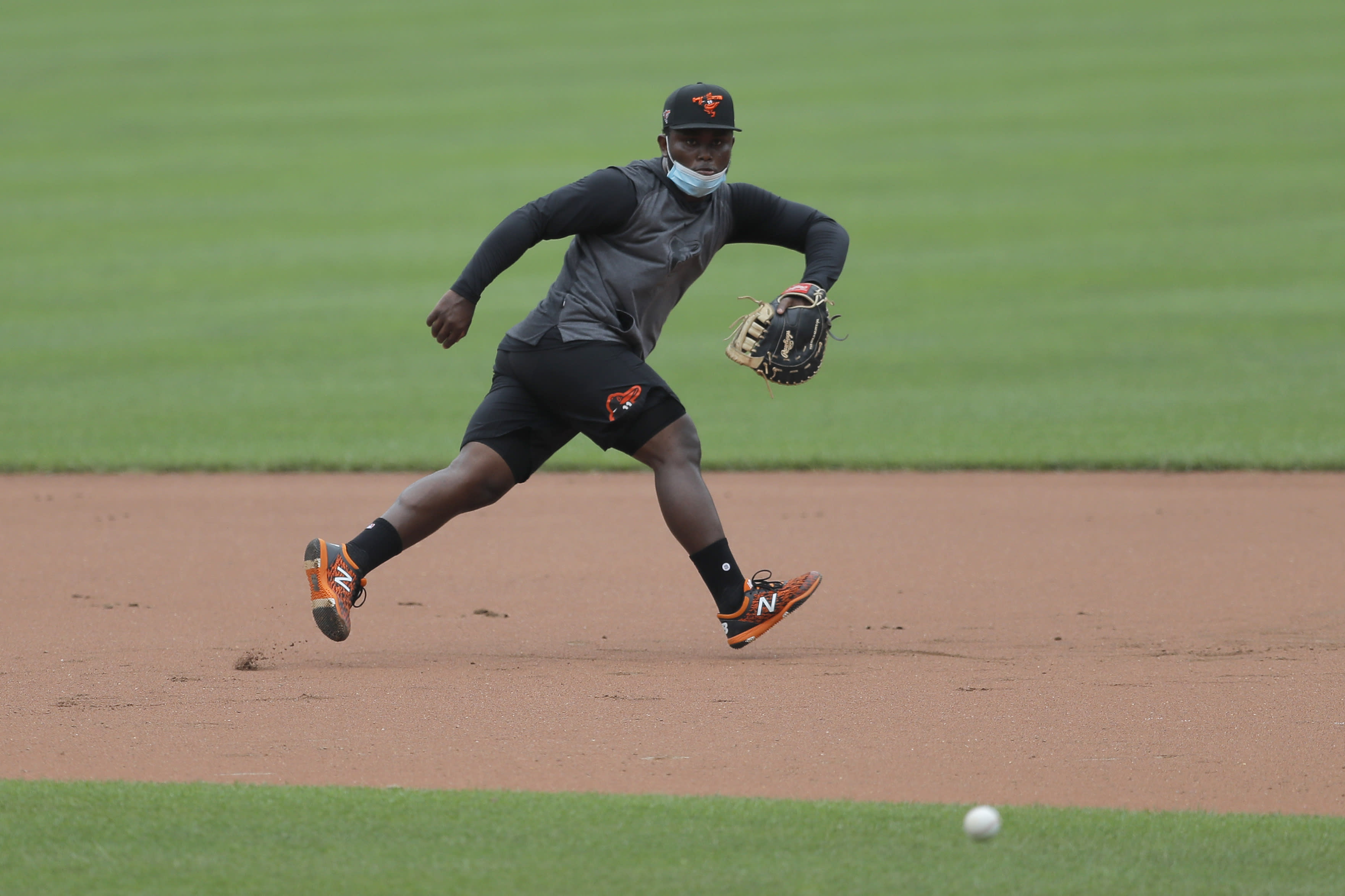 Baltimore Orioles infielder Dilson Herrera fields a ground ball during baseball training camp, Tuesday, July 7, 2020, in Baltimore. (AP Photo/Julio Cortez)