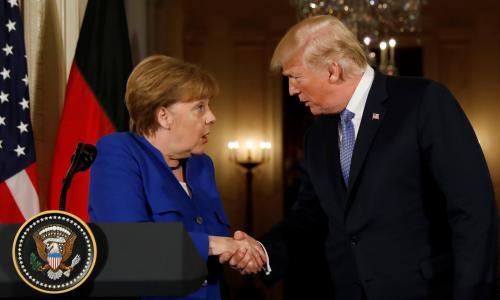 Trump and Merkel tried – and failed – to hide their differences in Washington