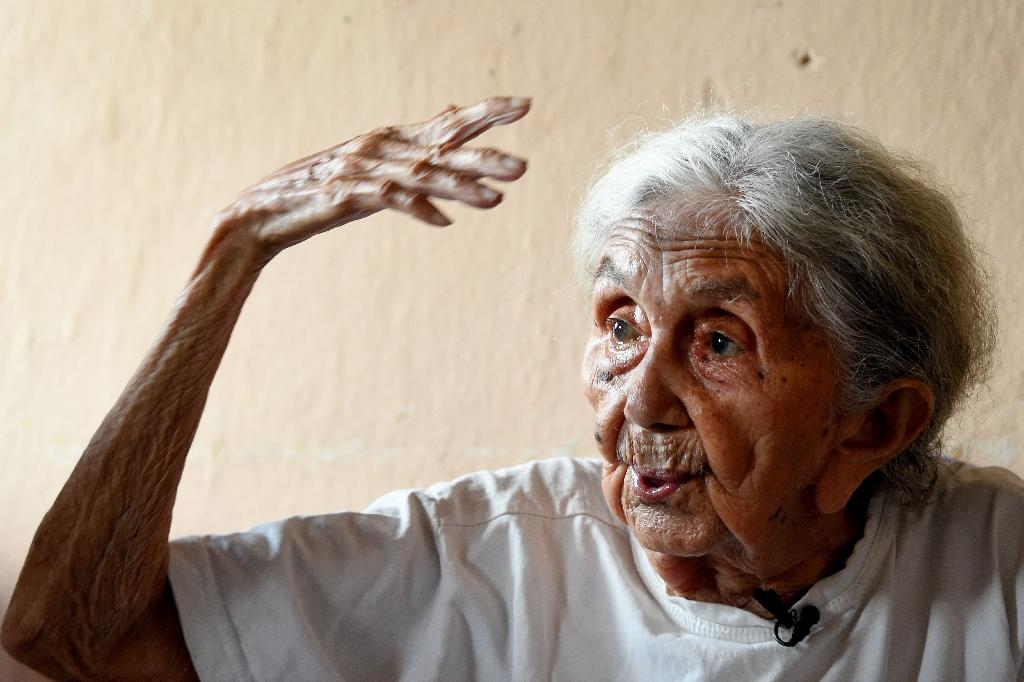 """Carmela Gomez Pinheiro says: """"Every day four or five people died, including children"""" (AFP Photo/EVARISTO SA)"""