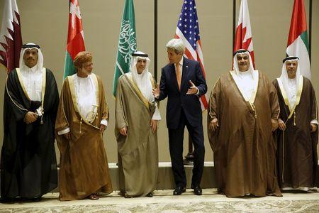 Qatar's Foreign Minister Mohammed bin Abdulrahman bin Jassim Al-Thani (L-R), Oman's Foreign Minister Yusuf bin Alawi, Saudi Arabia's Foreign Minister Adel al-Jubeir, U.S. Secretary of State John Kerry, Bahrain's Foreign Minister Khalid bin Ahmed Al Khalifa and UAE Minister of State for Foreign Affairs Anwar Gargash stand together for a family photo at the start of the Gulf Cooperation Council (GCC) ministerial meetings in Manama, Bahrain April 7, 2016. REUTERS/Jonathan Ernst