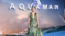 Amber Heard wears, what looks like, a designer swimming cap on the red carpet