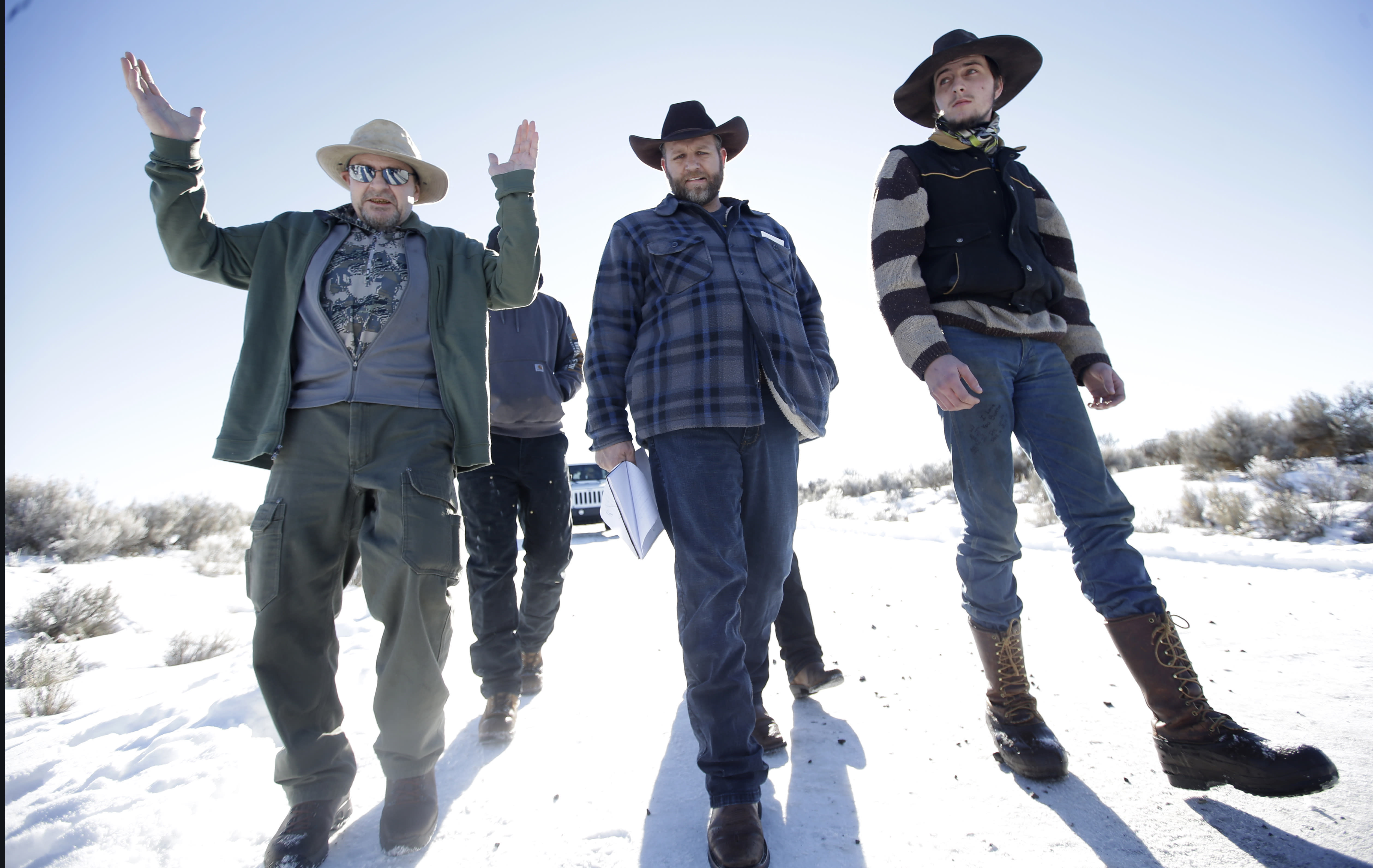 FILE - In this Jan 8, 2016, file photo, Burns resident Steve Atkins, left, talks with Ammon Bundy, center, one of the sons of Nevada rancher Cliven Bundy, following a news conference at Malheur National Wildlife Refuge near Burns, Ore. Bundy's family played central roles in a 2014 standoff over grazing fees in Nevada and the 2016 occupation of Oregon's Malheur National Wildlife Refuge. (AP Photo/Rick Bowmer, File)