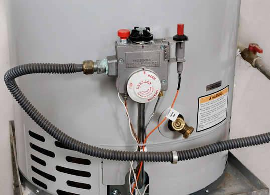 """<p>If you don't have a jacket for your <a href=""""http://www.bobvila.com/articles/types-of-water-heaters/"""" rel=""""nofollow noopener"""" target=""""_blank"""" data-ylk=""""slk:water heater"""" class=""""link rapid-noclick-resp"""">water heater</a>, odds are you're wasting the warmth. Consider insulating your unit to reduce heat loss and save a little cash—about $20 a month, according to the U.S. Department of Energy. To test to see if your water heater needs additional insulation, simply touch it. If it feels warm, it could probably use a blanket, but check your owner's manual first to make sure your model can be covered. <i>Photo: fotosearch.com</i><br>RELATED: <a href=""""http://www.bobvila.com/slideshow/8-things-new-homeowners-waste-money-on-49075"""" rel=""""nofollow noopener"""" target=""""_blank"""" data-ylk=""""slk:8 Things New Homeowners Waste Money On"""" class=""""link rapid-noclick-resp"""">8 Things New Homeowners Waste Money On</a></p>"""