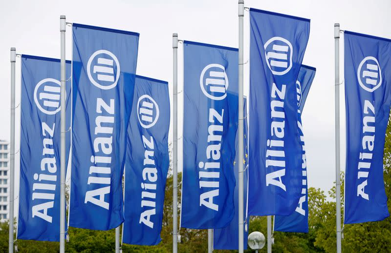FILE PHOTO: Flags with the logo of Allianz SE, Europe's biggest insurer, are pictured in Munich