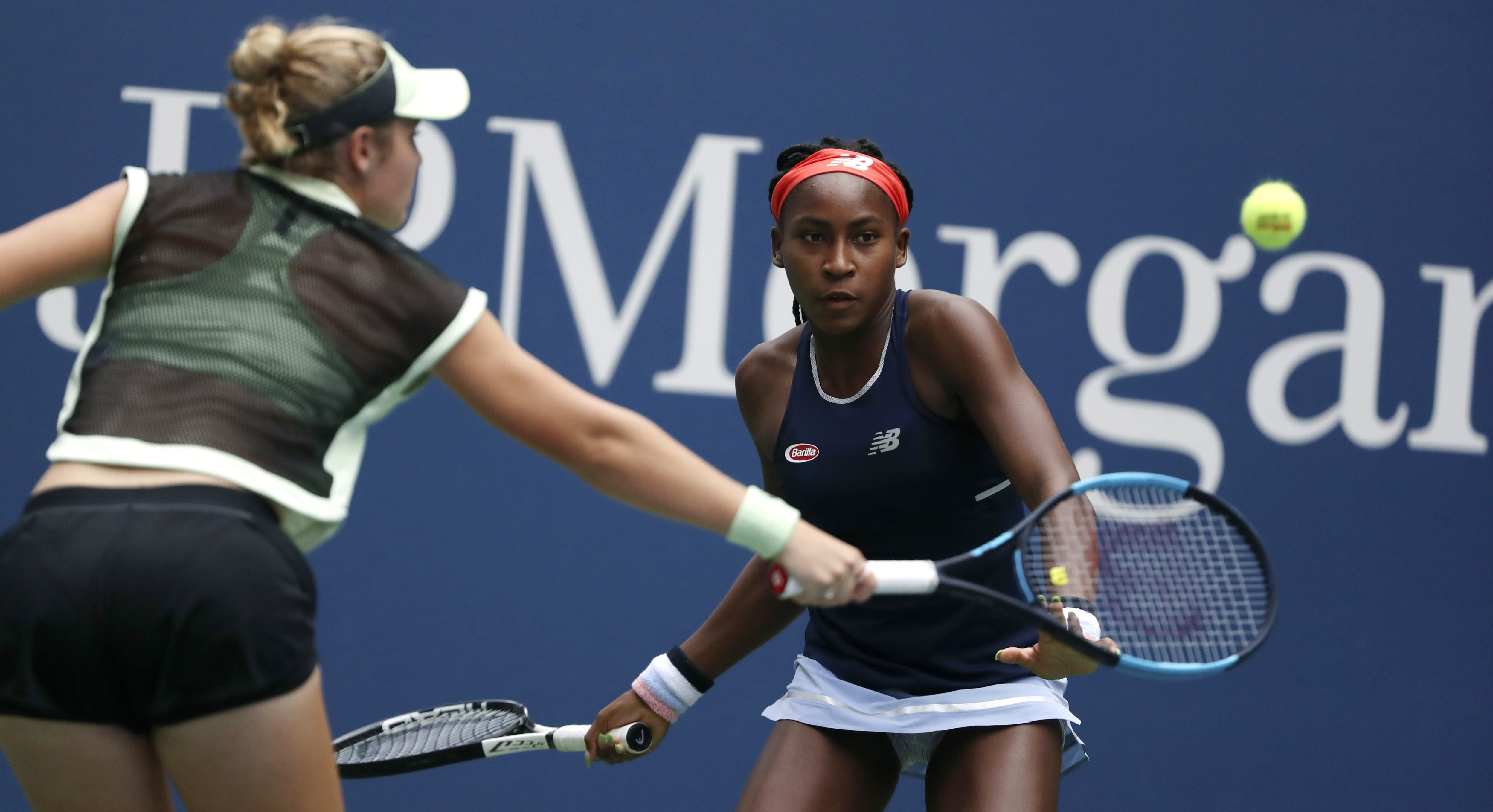 Coco Gauff, right, watches as her partner Catherine McNally returns during their women's doubles second round match against Nicole Melichar and Kveta Peschjka at the US Open tennis championships Sunday, Sept. 1, 2019, in New York. (AP Photo/Kevin Hagen)