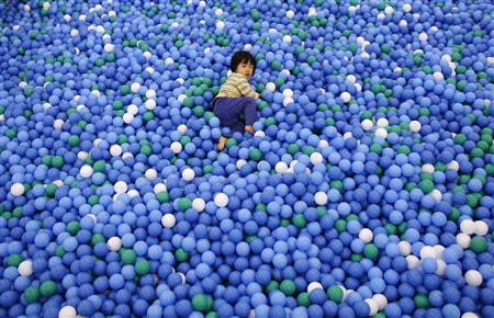 Two-year-old Nao Watanabe plays in a ball pit at an indoor playground which was built for children and parents who refrain from playing outside because of concerns about nuclear radiation in Koriyama, west of the tsunami-crippled Fukushima Daiichi nuclear power plant, Fukushima prefecture February 27, 2014. REUTERS/Toru Hanai