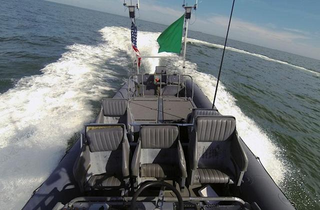 US Navy's drone 'swarmboats' show off pack tactics