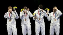 Fencer protests gun violence, IOC with 'X' written on hand