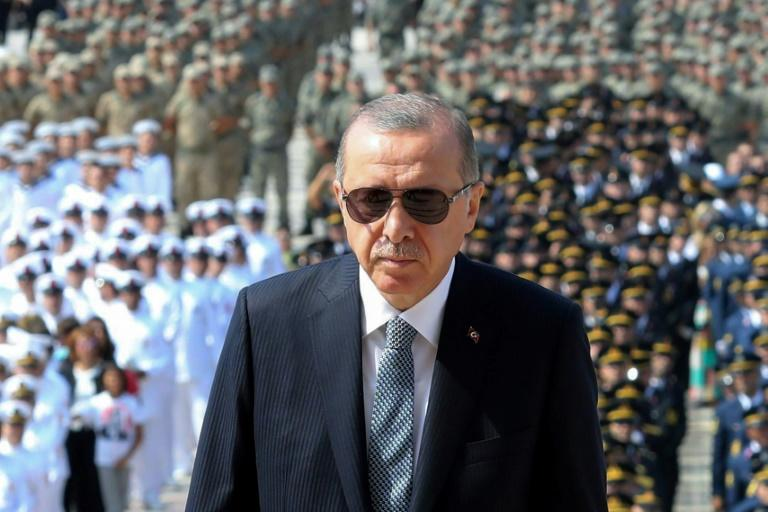 Turkish President Recep Tayyip Erdogan (C) has come under fire for undermining judicial independence