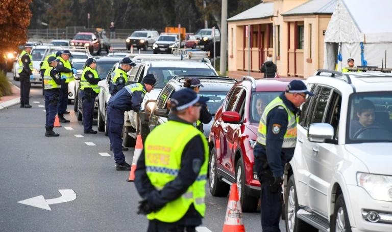 Queues of cars were backed up at Victoria's border after neighbouring New South Wales closed the boundary, essentially sealing off the state from the rest of Australia (AFP Photo/William WEST)