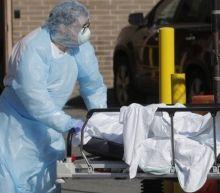 Coronavirus deaths in US top 100,000