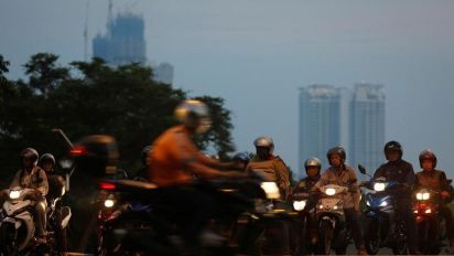 Malaysia defends ride-hailing laws after media report U.S. probe into Uber dealings