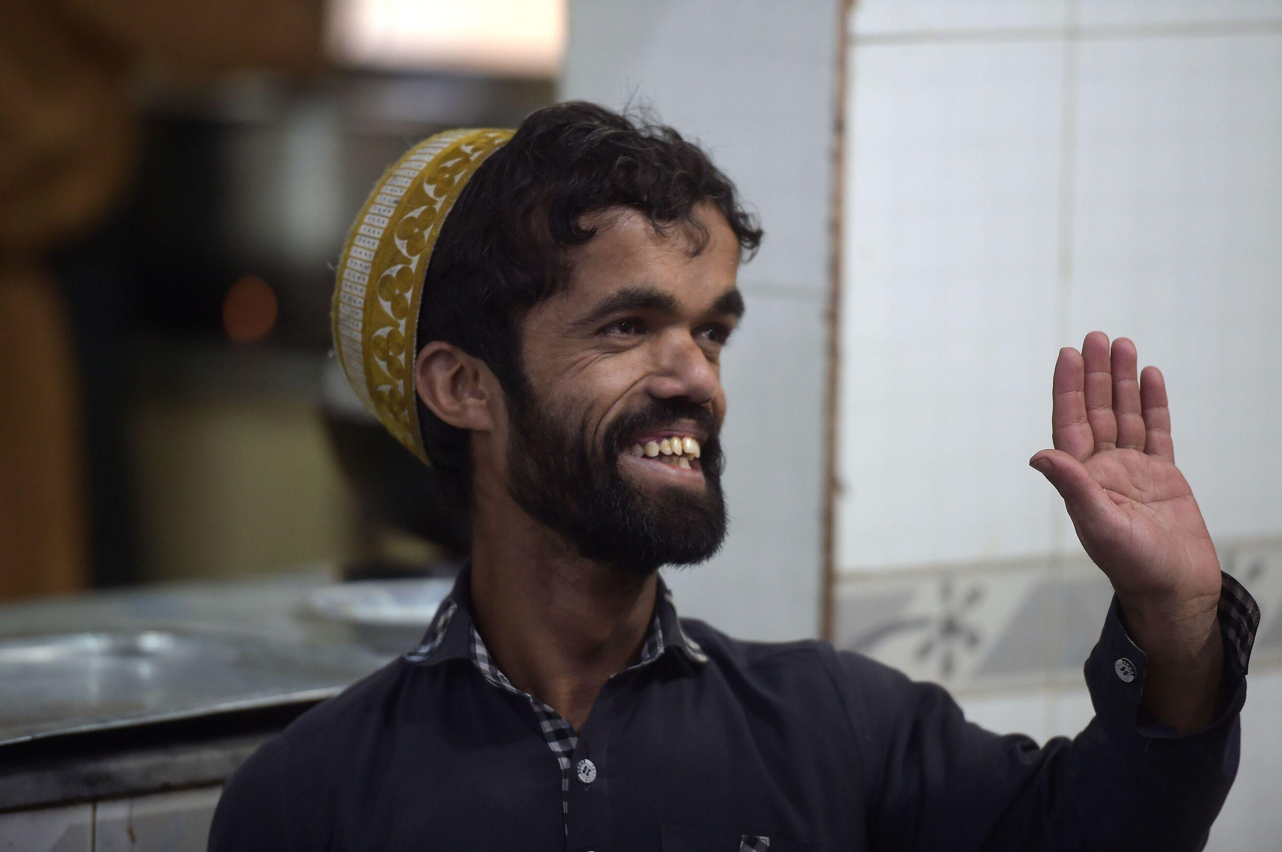In this picture taken on February 22, 2019, Pakistani waiter Rozi Khan, 25, who resembles US actor Peter Dinklage, waving to customers at Dilbar Hotel in Rawalpindi. - Rozi Khan had never heard of the Game of Thrones -- or its hugely popular character Tyrion Lannister -- until his striking resemblance to the dwarf anti-hero got heads turning at home. (Photo by AAMIR QURESHI / AFP) / To go with PAKISTAN-LIFESTYLE-TELEVISION-ENTERTAINMENT        (Photo credit should read AAMIR QURESHI/AFP/Getty Images)