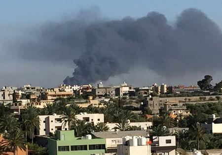 Smoke rises during a fight between members of the Libyan internationally recognised government forces and Eastern forces in Ain Zara, Tripoli