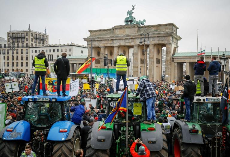 Farmers with their tractors and protestors gathered in front of the Brandenburg Gate in Berlin against the German government's agricultural policy including plans to phase out glyphosate pesticides