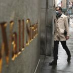 Wall Street eases after strong rally as virus cases surge