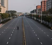 China said it would relax its lockdown of Wuhan's 11 million residents, only to immediately reintroduce it