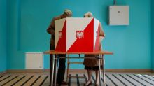 Poles vote in presidential election that highlights country's deep divisions
