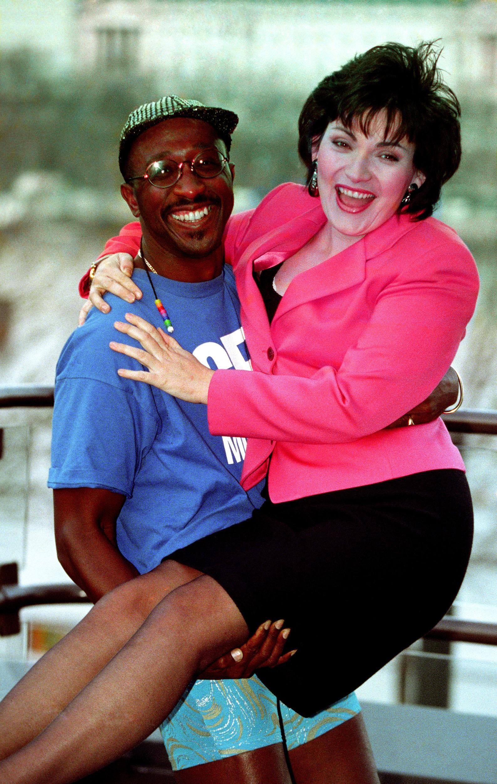 Lorraine kelly welcomed back to GMTV by the breaskfast channel's Mr Motivator. Lorraine will return in the new year to present her own programme between 8.45-9.25.