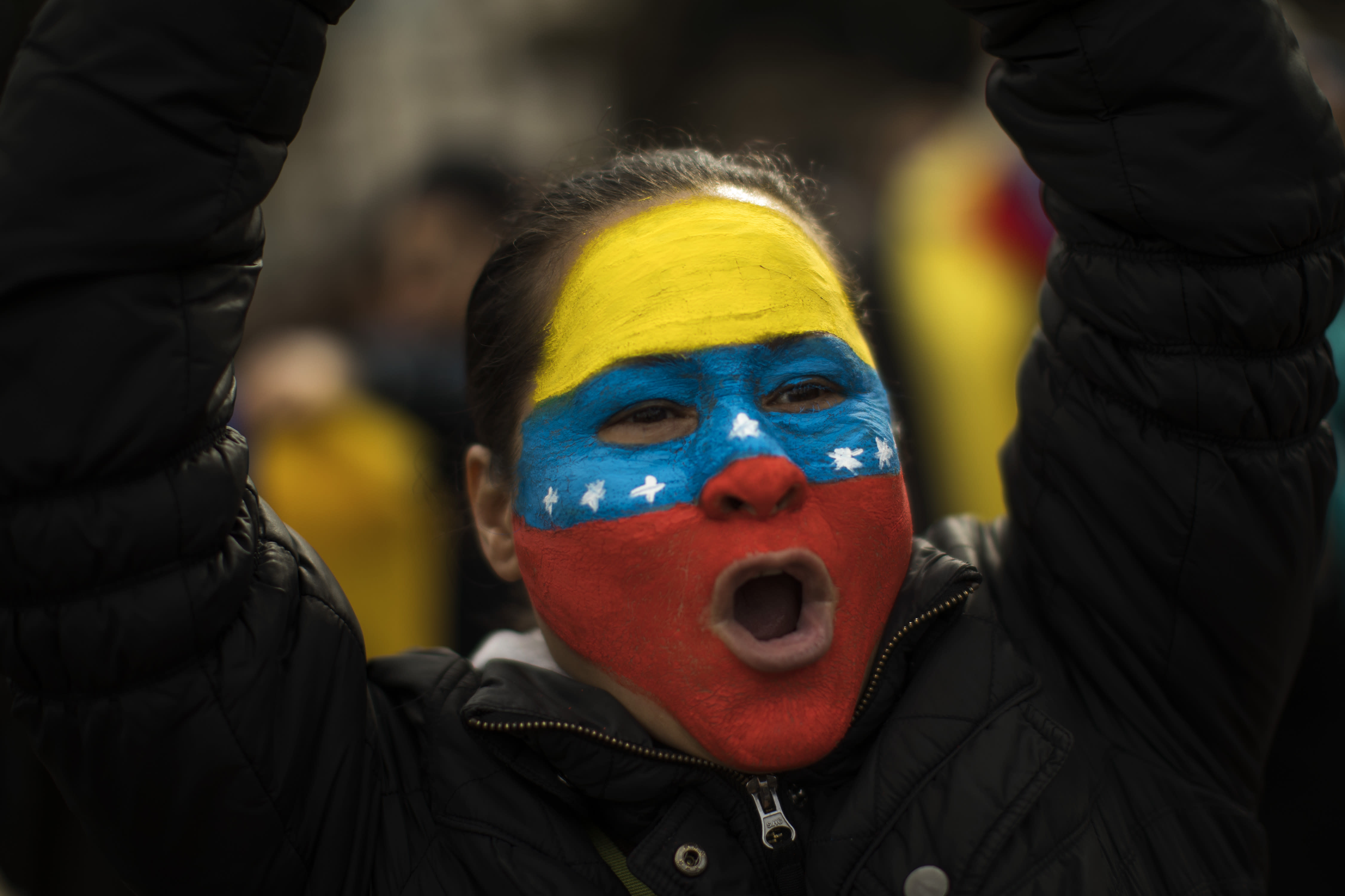 A Venezuelan woman shouts slogans as she takes part in a rally in Catalonia square, in Barcelona, Spain, Saturday, Feb. 2, 2019. Hundreds of Venezuelans gathered in downtown Barcelona, to express their support for Juan Guaido, who declared himself interim president of Venezuela last week. The gathering was one of several expected around the world to coincide with a rally planned by Guaido in Venezuela. (AP Photo/Emilio Morenatti)