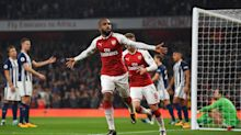 Arsenal rides some luck, then takes care of West Brom, 2-0