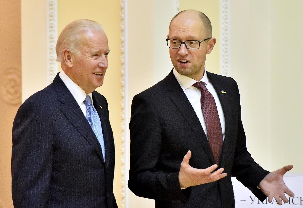 US Vice President Joe Biden (L) talks with Ukrainian Prime Minister Arseniy Yatsenyuk on December 7, 2015, during a three-day working visit intended to signal support for Kiev amid its ongoing clash with Moscow US Vice President Joe Biden, on a three-day working visit to Ukraine, said the world's focus on Syria did not overshadow Western demands for Russia to adhere to a shaky Ukrainian peace agreement and to hand back Crimea to Kiev. (AFP Photo/Sergei Supinsky)