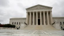 Shorthanded U.S. Supreme Court kicks off new term amid drama