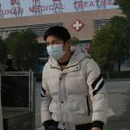 China locks down cities to curb virus outbreak