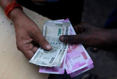Rupee, Indonesian rupiah, Thai baht fall as oil prices surge