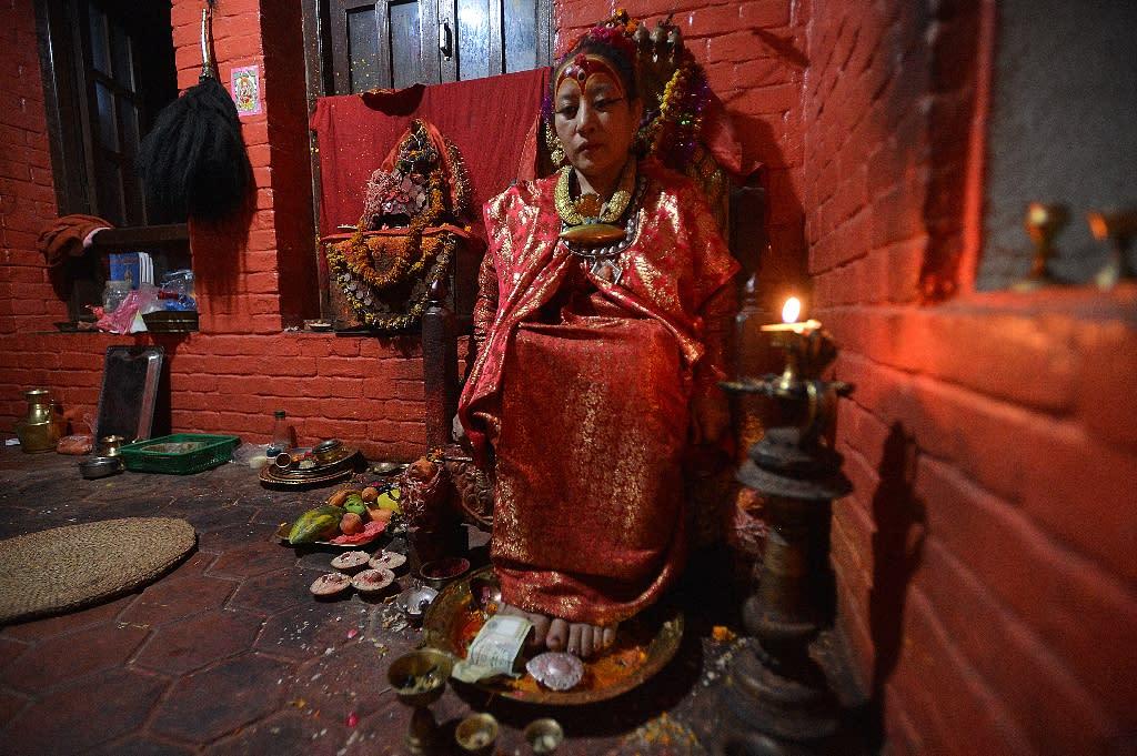 Nepal has seen sweeping changes during Bajracharya's lifetime, transforming from a Hindu kingdom to a secular republic, but the former Kumari's daily routine remains the same (AFP Photo/Ishara S. Kodikara )