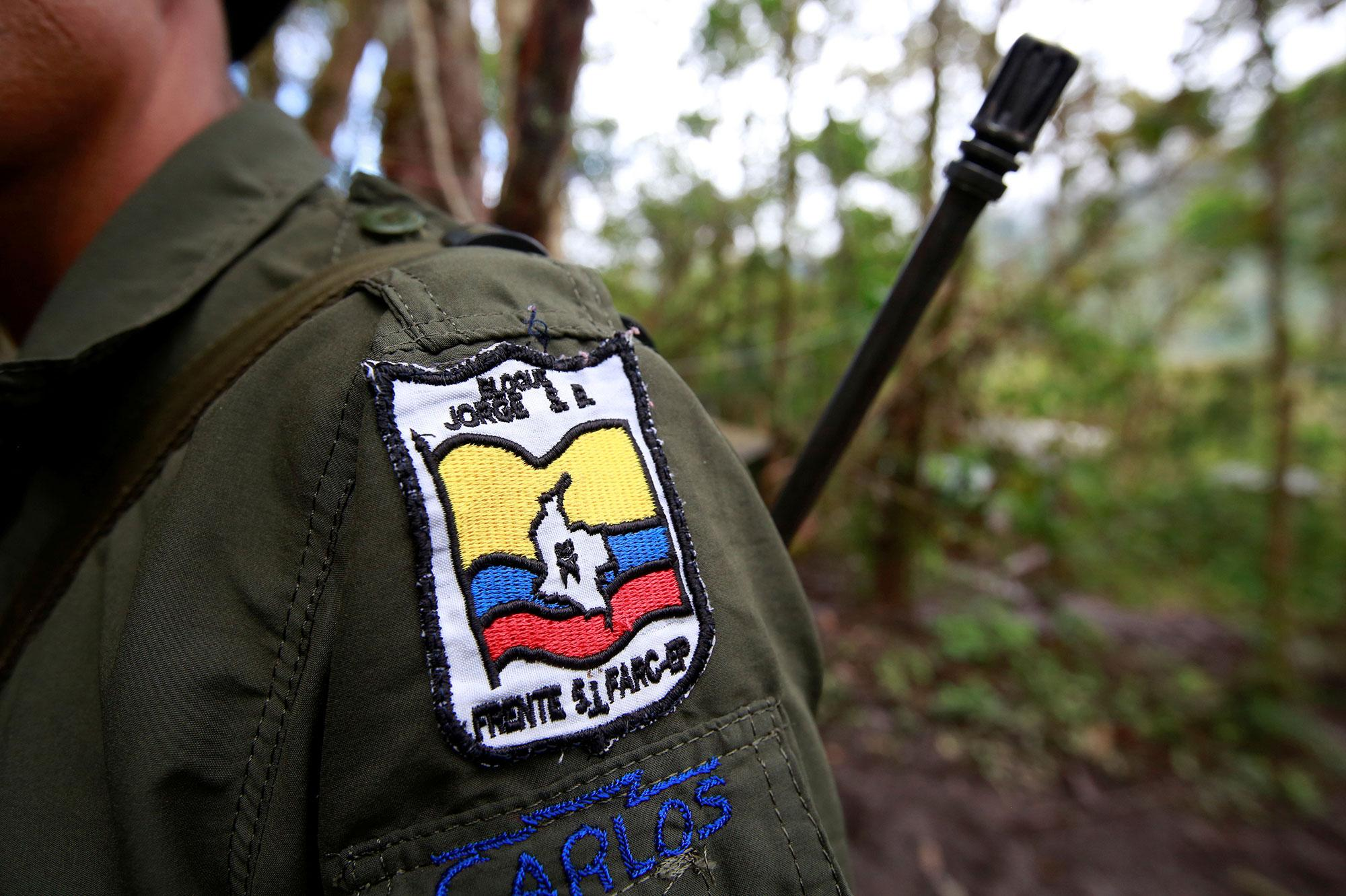 <p>Carlos, a member of the 51st Front of the Revolutionary Armed Forces of Colombia (FARC), is seen at a camp in Cordillera Oriental, Colombia, August 16, 2016. (John Vizcaino/Reuters) </p>