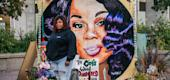 Tamika Palmer, mother of Breonna Taylor, in front of a mural of her daughter. (Getty Images)