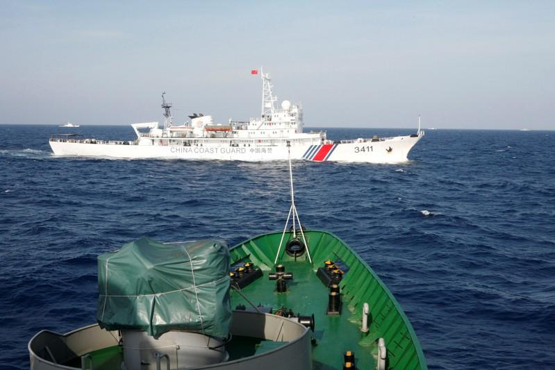 FILE PHOTO: A ship of Chinese Coast Guard is seen near a ship of Vietnam Marine Guard in the South China Sea