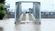 Hundreds of rivers swell as China summer flood season revs up
