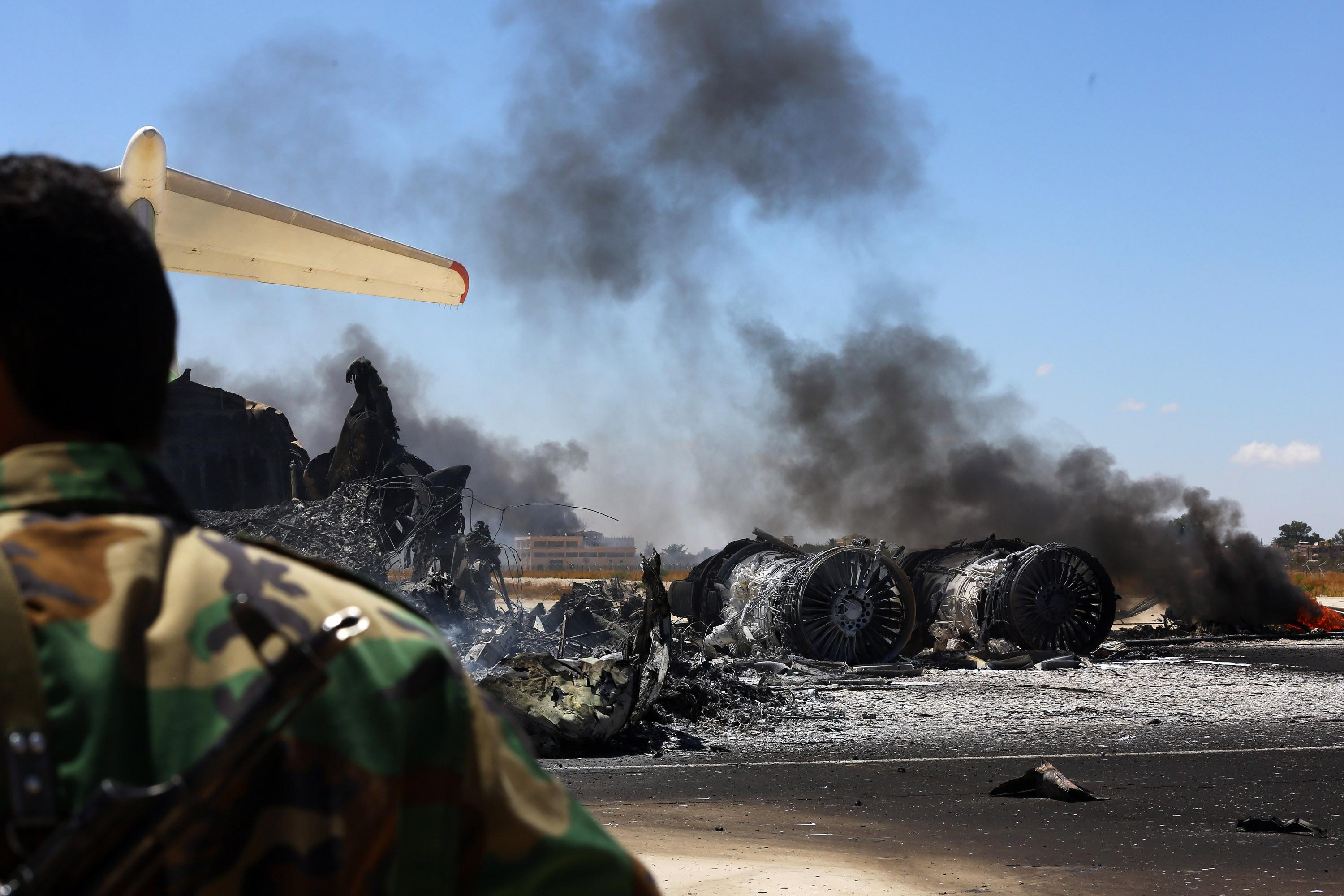 A picture taken on July 16, 2014, shows the remains of a burnt airplane at the Tripoli international airport in the Libyan capital (AFP Photo/Mahmud Turkia)