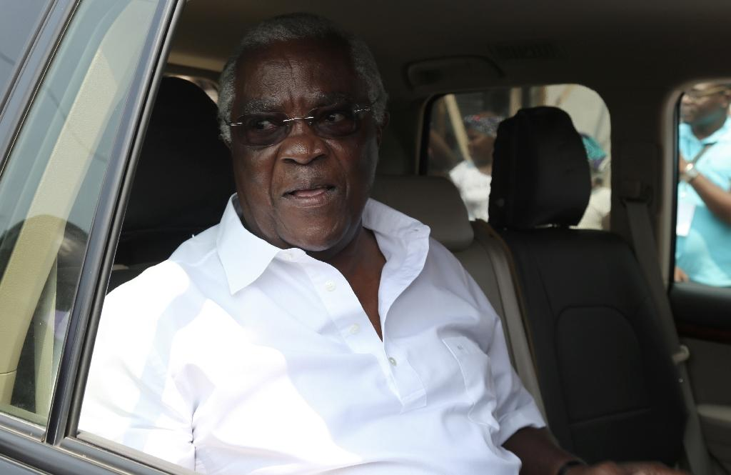 Sao Tome and Principe's incumbent President Manuel Pinto da Costa sitting in his car after voting during presidential elections in the capital Sao Tome on July 17, 2016 (AFP Photo/Samir Tounsi)