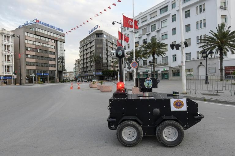 A Tunisian police robot patrols the streets of the capital Tunis to enforce a nationwide lockdown imposed by the authorities in their fight against coronavirus